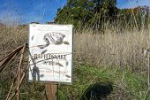 A sign cautions hikers to rattlesnake danger in Sonoma County wine country at Jack London State Historic Park, Glen Ellen, California. poster