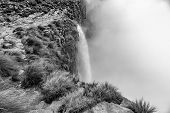 Monochrome view of the Tugela Falls, the second tallest waterfall on earth. The Tugela River plunges 948 m in five steps from the top of the Amphitheatre in the Drakensberg poster