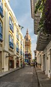 Cartagena, Colombia. March 2018. A view of a typical street with the pink domed, Cathedral of Cartagena also visible in Cartagena colombia poster
