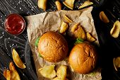 Top view of tempting fast food diner with burgers and potatoes poster