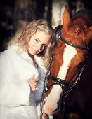 portrait of young bride with horse sunny evening poster