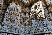 Ornate wall panel reliefs depicting Goddess Kali on the left and Vamana incarnation of Vishnu on the right, Hoysaleshwara temple, Halebidu, Karnataka, India. poster