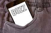 Word writing text Buzz. Business concept for Hum Murmur Drone Fizz Ring Sibilation Whir Alarm Beep Chime Cell phone jean pocket white screen message communicate applications poster