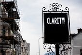 Writing note showing  Clarity. Business photo showcasing Certainty Precision Purity Comprehensibility Transparency Accuracy Vintage black board sky old city ideas scaffolding landscapes antique poster
