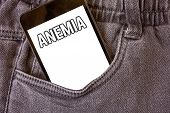 Word writing text Anemia. Business concept for Bloodlessness Disease Severe Blood Loss Illness Sick Iron Deficiency Cell phone jean pocket white screen message communicate applications poster