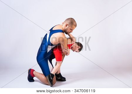 The Concept Of Child Power And Martial Arts Training. Teaching Children Greco-roman Wrestling. Boy A