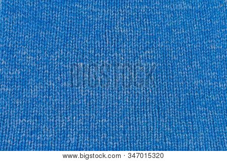 Needlework, Hobbies, Knitting. Background Textile Fabric With A Knitted Texture Wool Blue. Blue Knit