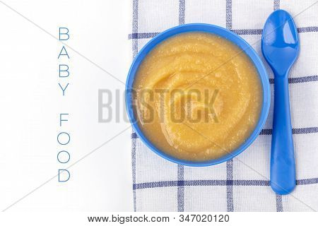 Baby Food. Fresh Homemade Applesauce. Blue Bowl With Fruit Puree On Fabric. The Concept Of Proper Nu