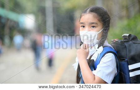 Portrait Asian Children Girl Wear  Mask To Protect Pm 2.5 Dust And Air Pollution. Portrait Of Thai S
