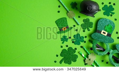 St Patricks Day Banner Design With Irish Elf Hats, Pot Of Gold, Shamrock Leaf Clovers, Glasses On Gr