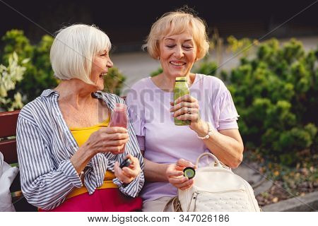 Happy Ladies Having A Healthy Snack Together