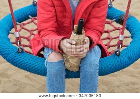 Teenager On A Swing Drinks Illegal Drinks, Drinking Alcohol By Children