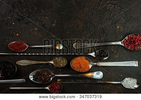 Selective Focus, Copper Tablespoons And Teaspoons With Cooking For Cooking, On A Dark Background