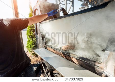 Large Barbecue Smoker Grill At The Park. Meat Prepared In Barbecue Smoker.