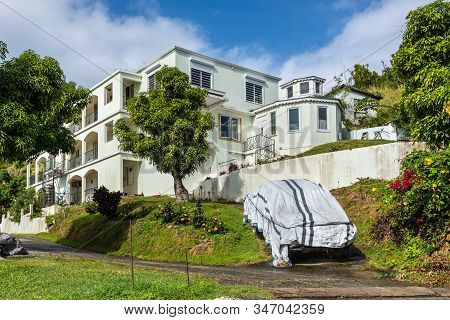 Tortola, British V. Islands - December 16, 2018: Residential Building On The Slopes Of Scattered Roa