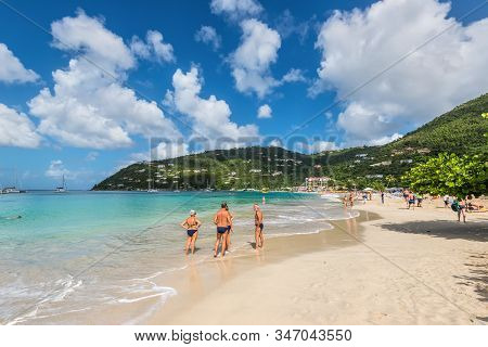 Cane Garden Bay, Tortola, Bvi - December 16, 2018:  People Relax On The Famous Cane Garden Bay, A Po