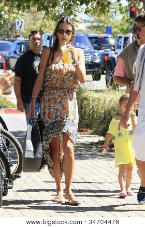 MALIBU - JUL 8: Alessandra Ambrosio, daughter Anja enjoying a walk and some iced tea on a hot day on July 8, 2012 in Malibu, California