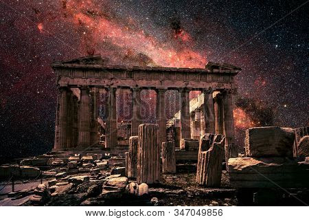 Athens At Night, Greece. Fantasy View Of Famous Parthenon On Acropolis And Milky Way. Beautiful Star