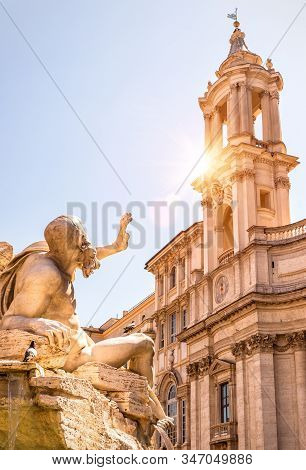 Navona Square In Rome, Italy. Detail Of Old Four Rivers Fountain And Sant'agnese Church. Piazza Navo