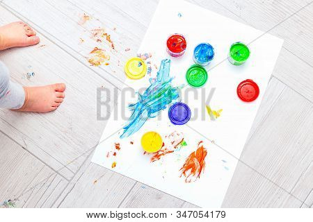 Baby Feet And Finger Paints Multi-colored. Flat Lay