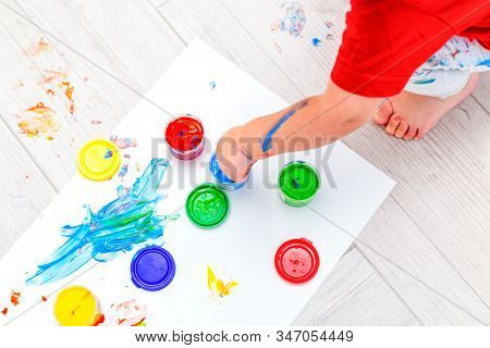Baby Hands Drawing  Multi-colored Finger Paints. Flat Lay. Artwork