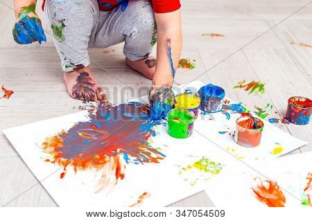 Children's Hands And Feet In Paint. Finger Paints. Baby Artwork. Flat Lay