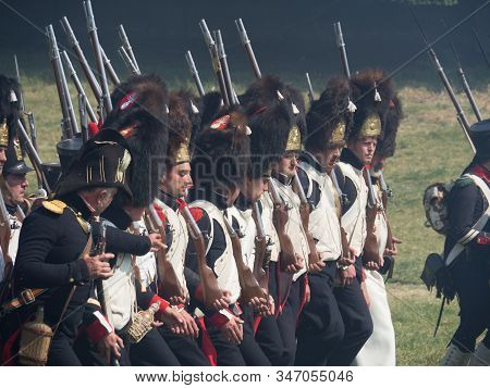 Waterloo, Belgium - June 18 2017: French Soldiers Of The Imperial Guard Advancing Towards The Allies