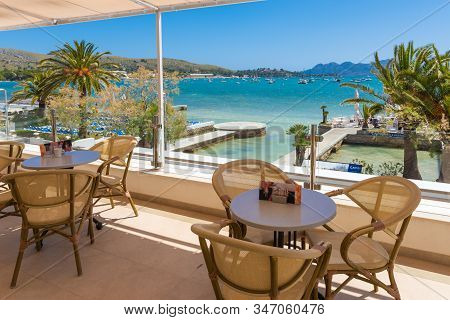 Mallorca, Spain - May 6, 2019: A Restaurant Overlooking The Bay And The Beach At Port De Pollenca In