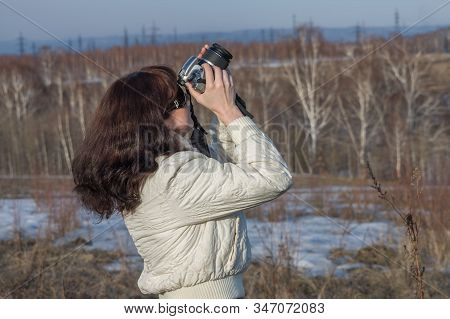 A Girl Takes Pictures With A Digital Slr Camera
