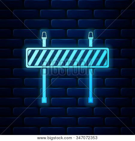 Glowing Neon Road Barrier Icon Isolated On Brick Wall Background. Fence Of Building Or Repair Works.