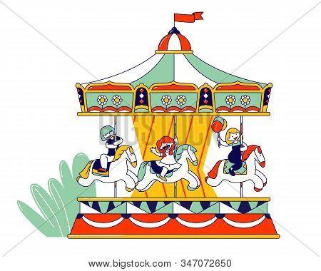 Happy Children Riding Merry-go-round Carousel In Amusement Entertainment Park. Weekend Recreation Fo