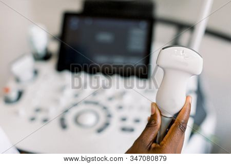 Close Up Photo Of Ultrasound Scanner In The Hands Of Female African American Doctor. Diagnostics. So