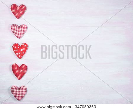 Plush Hearts On A Lilac Wooden Background With Space For Text On The Right.