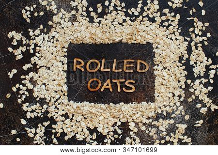 Rolled Oats Top View On A Dark Table With A Word Rolled Oats