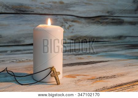 Funeral Ceremony Concept, Burning Candle With Light. White Wooden Background.