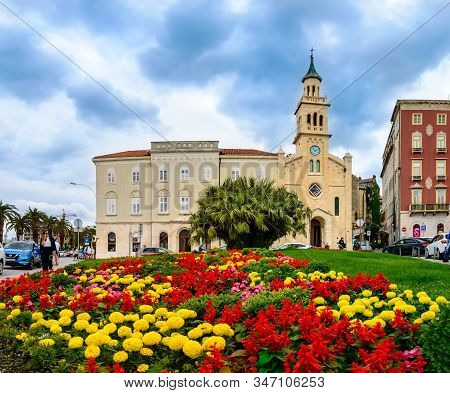 Split, Croatia - May 21, 2019: The Church And Monastery Of St. Frane With Colorful Yellow And Red Fl