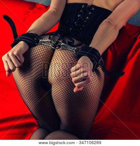 Adult Sex Games. Submissive Girl In Bondage Prepare For Punishment. - Image Toned