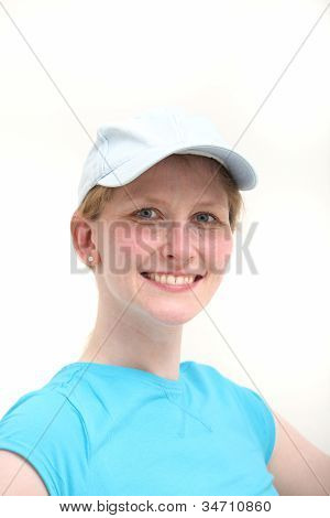 Smiling Woman In White Baseball Cap