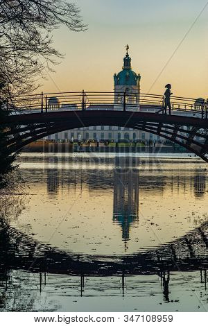 Berlin, Germany- November 16, 2018: Bridge Crossing The Lake Of Charlottenburg Palace In Evening Sun