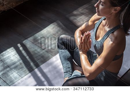 Calm Fit Sporty Healthy Mindful Woman Sit In Lotus Pose Doing Yoga Exercise Breathing Fresh Air Medi