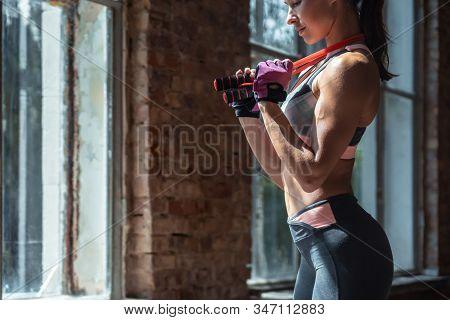 Sportive Active Young Fit Bodybuilder Woman Standing In Brick Wall Windows Gym Holding Jumping Skipp