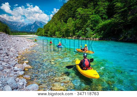 Famous Rafting And Kayaking Place. Active Kayakers In Colorful Life Jacket Paddling And Exercising O