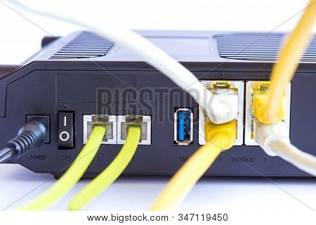 Modem Adsl And Ethernet Cables Connection Concept.