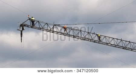 Gosford, Australia May 11, 2019: Riggers High Up Working On The Tower Crane Erection And Installatio