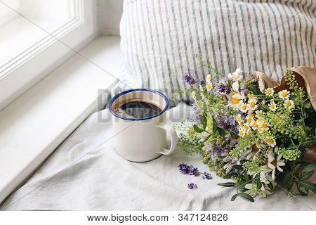 Summer Breakfast Scene. Enamel Mug, Wild Flowers Bouquet And Linen Cushion. Vintage Feminine Photo,