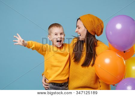 Woman In Yellow Clothes Have Fun With Cute Child Baby Boy 4-5 Years Old Celebrating Birthday Holiday