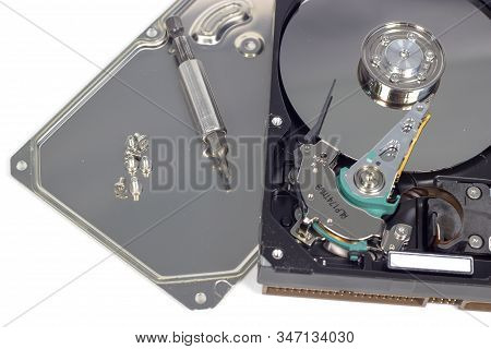 Disassemble A Hard Drive From A Computer, A Hard Drive With A Mirror Effect A Hard Drive From A Comp