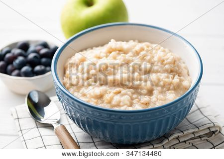 Healthy Breakfast Oatmeal Porridge In Bowl. Warm Porridge Oats, Vegan Vegetarian Weight Loss Dieting