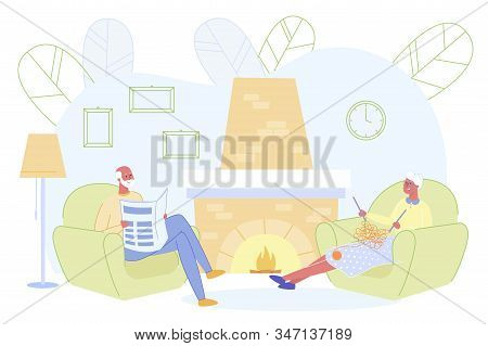 Senior Couple Relaxing Sitting In Living Room With Burning Fireplace, Woman Knitting Clothing, Man R