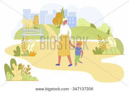 Grandmother And Little Grandson Walking In City Park At Summertime. Senior Woman Holding Boy By Hand